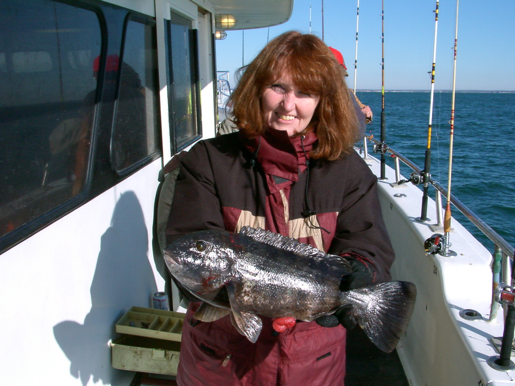 Mar e with a nice tautog or blackfish her first for Frances fleet fishing